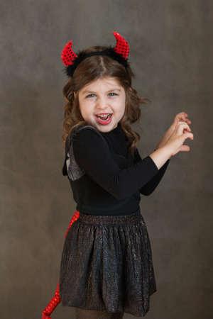 Emotional European little girl in haloween damn costume
