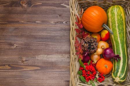 harvest cone cornucopia: fresh autumn vegetables in a basket pumpkin, apple, cone, onion