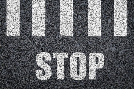 road marking: White pedestrian crossing road marking with stop sign