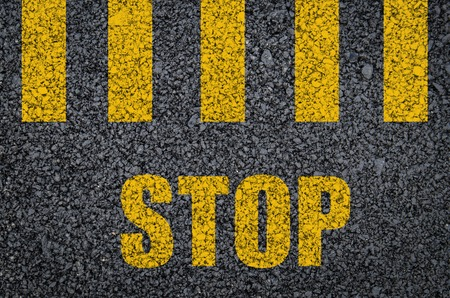 painted lines: Yellow pedestrian crossing road marking with stop sign