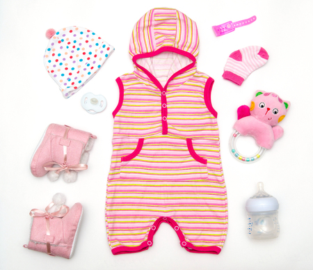 stuff toy: top view of baby girl clothes and toy stuff, baby fashion concept Stock Photo