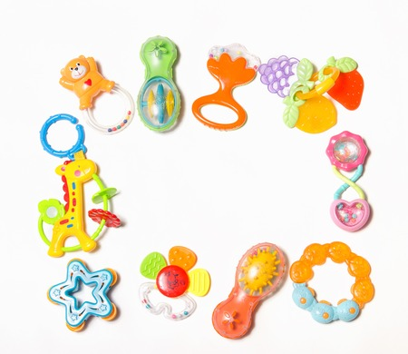 Set of plastic toys for newborn isolated on white