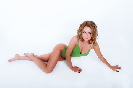 Girl lies in green underwear