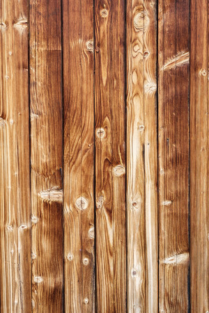 old wallpaper: horizontal fragment texture of old yellow wooden blockhouse