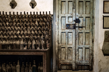 casks: Old sherry bottles in Jerez bodega, Spain Stock Photo