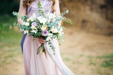 arm bouquet: woman holding on to a beautiful flower bouquet Stock Photo