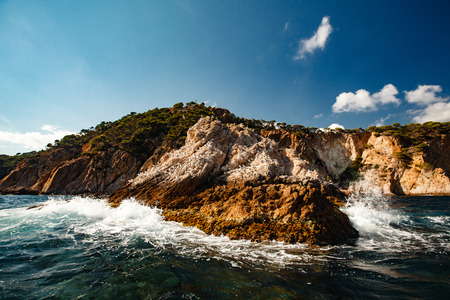 View of the coastal cliff with gulls from the open sea, costa brava Stock Photo
