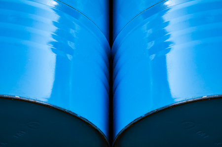 abstract background of metal barrels of blue color. Stockfoto