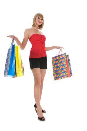 expresiva mujer sobre fondo blanco de compras Foto de archivo