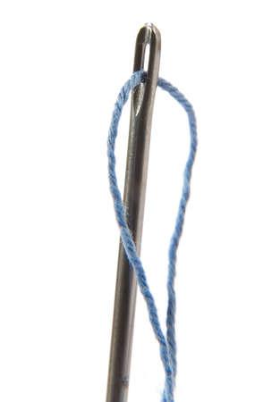 needle with thread on white background Stock Photo - 5409476