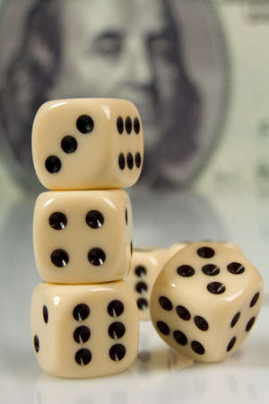 Dice on big dollar background photo