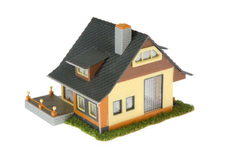 Miniature house isolated on white background photo