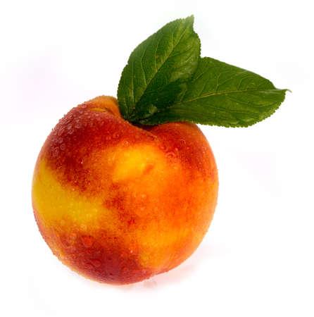 yellows: ripe peach on a white background. Stock Photo
