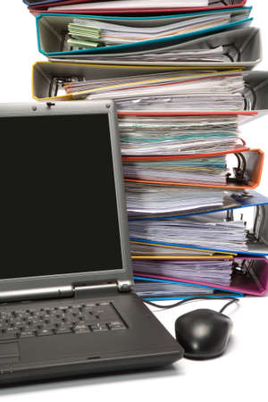 Isolated stack of folders with laptop computer shot over white background