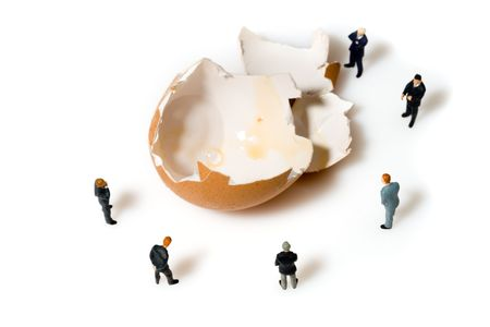business team with a egg isolated over a white background Stock Photo - 6750396