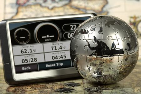 Car navigator on the old map. Concept travel. photo