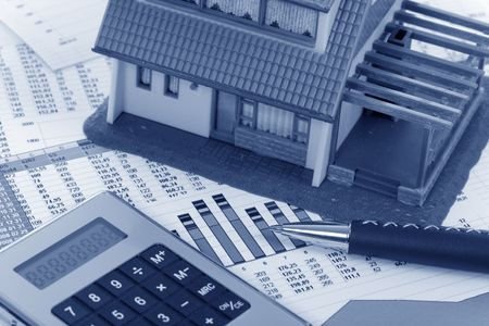 Model house and calculator on construction plan  Stock Photo - 6859999