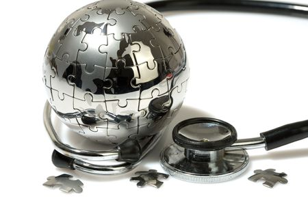 Globe puzzle on white background. Medical concept. photo