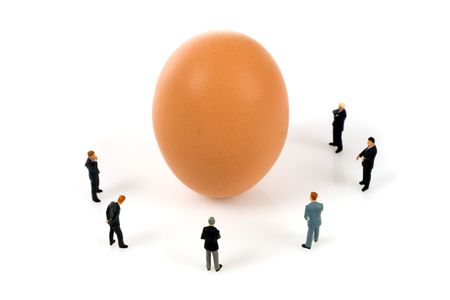 business team with a egg isolated over a white background Stock Photo - 6859640