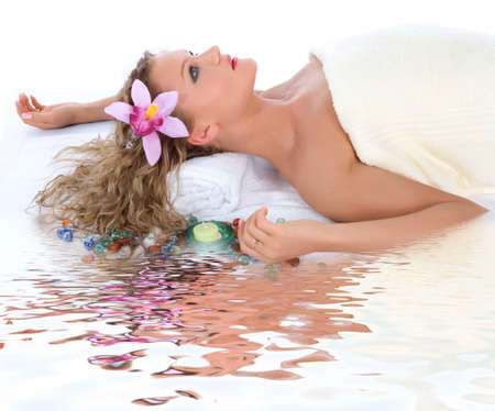 Attractive woman getting spa treatment on white Stock Photo - 7226251