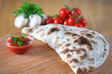 Pizza calzone with close up Stock Photo
