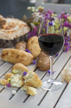 White French Bread on Wooden board with glass of Wine