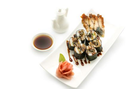 Maki sushi, rolls, nori rice, smoked eel sheets, sesame seeds and teriyaki sauce on a white background