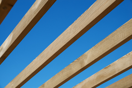rafters: Boards against the blue sky, in a diagonal frame