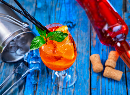 Spritz Aperol cocktail in a glass and ice cubes on a rustic wooden background, copy space. Stock Photo