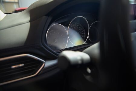 modern car speedometer and odometer at daytime. Concept of car sales, rent.