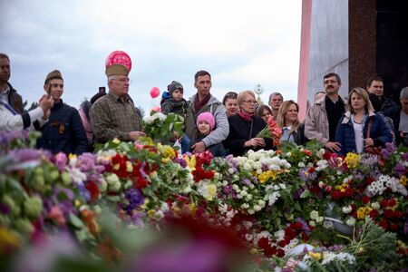 Chisinau, Moldova, May 9, 2019: Flowers and people on Victory Day, laying flowers at the eternal flame, celebrate the 74th anniversary of the Victory.