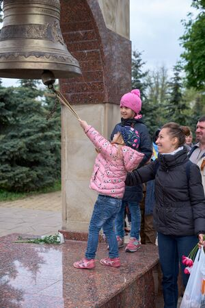 Chisinau, Moldova, May 9, 2019. People beat the bell three times in memory of the dead, celebrating the 74th anniversary of the Victory. Editorial