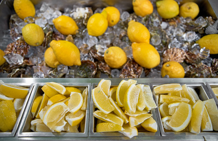 Showcase with Oysters and lemon on ice. Oyster shells, close up. the market street trading on a street, healthy food