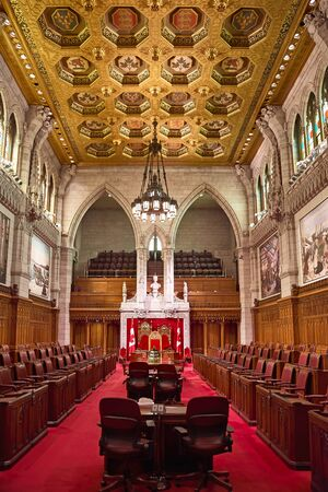 Ottawa, Canada, September 18, 2018: Interior of the Canadian Senate Chamber Parliament Hill. Beautiful gothic architecture, wood stone work. Political debates take place in this historical room. Éditoriale