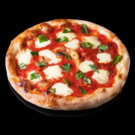 Pizza Margherita on black background. Pizza Margarita with Tomatoes, Basil and Mozzarella Cheese