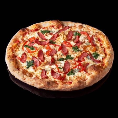 Pizza menu. Delicious hot pizza Mario with chicken, sausage and cheese. Delicious traditional Italian pizza on an isolated black background Stock Photo