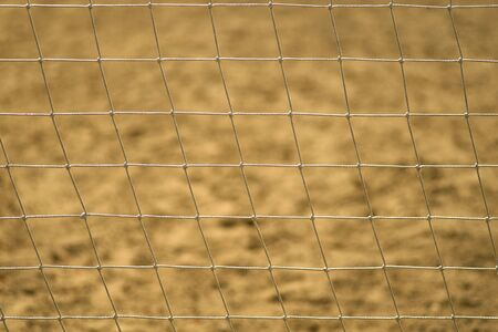 Football net close-up on the beach or Volleyball net on the street. Play outdoor.