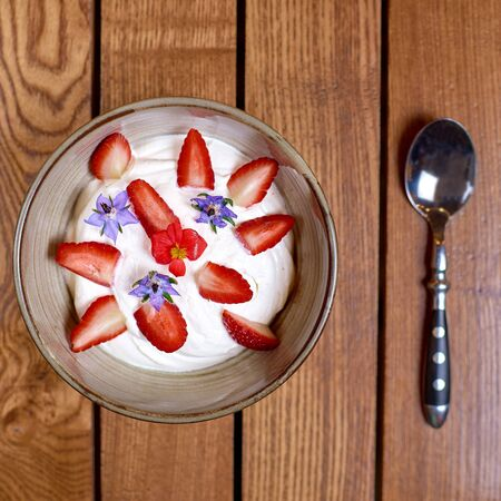 Delicious and healthy dessert. Dessert of strawberries with yogurt. Delicious and flavorful dessert. Healthy eating, Breakfast. Top view, copy space.