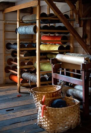 colored woolen threads on an old loom, Traditional Yarn in Canada.
