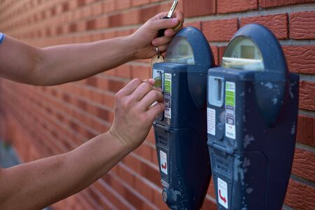 Close Up Of Man Putting Money In Parking Meter. 스톡 콘텐츠