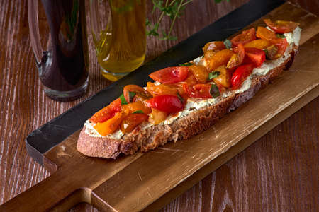 Caprese bruschetta toasts with cherry tomatoes, mozzarella and basil. with olive oil will help the body get the necessary vitamins and normalize the stomach.