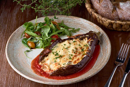 Baked eggplant, meat stews, tomatoes, cheese, delicious Italian dish healthy nutrition. Clean food