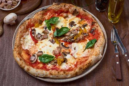 Pizza Turkey breast, mushrooms and mozzarella, smoked papillon cheese on black concrete background. Traditional Brazilian Pizza