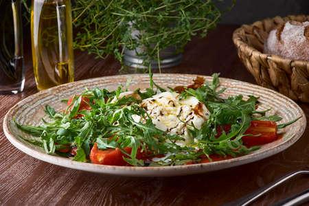 Closeup italian buratta salad with pesto and tomato