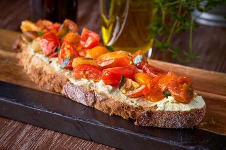 Bread toast with salted salmon, pesto sauce and cream cheese ricotta. Gourmet snack. selective focus Archivio Fotografico