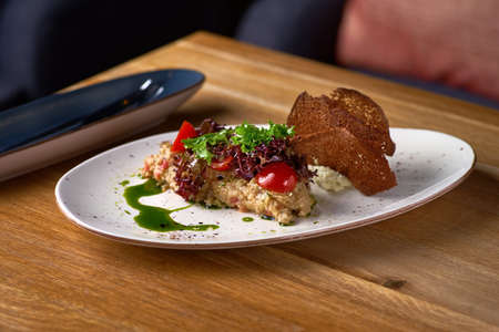 Eggplant caviar with cheese mousse on the table, serving in a restaurant, menu food concept. copy space.