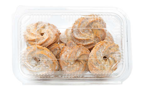 Food concept. In a container Shortbread with seeds, sugar. Isolated on a white background close up
