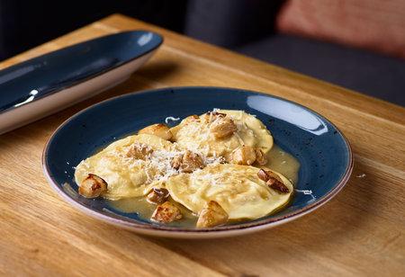 Rabbit ravioli with mushroom sauce and its rapeseed parmesan cheese