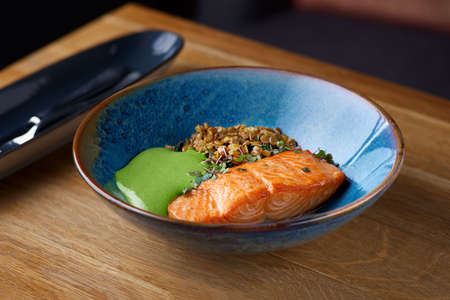 Baked Salmon with Green Lentils. Macrobiotic food concept. Healthy food.