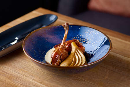 Exclusive restaurant meals. duck leg with apple and celery puree against table background, copy space Banque d'images